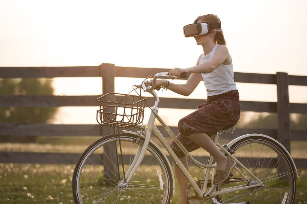 a girl using AR and riding a bike, showing AR as one of the top social media content trends